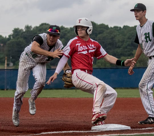 Seth Beeler of Huntington tags Nick Chetock of Toronto out after he was caught between bases during the regional semifinal game Thursday evening in Lancaster. Huntington lost the game ending their tournament run.
