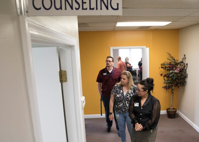 A tour winds its way through the newly remodeled offices of Spero Health during an open house on May 30, 2019.