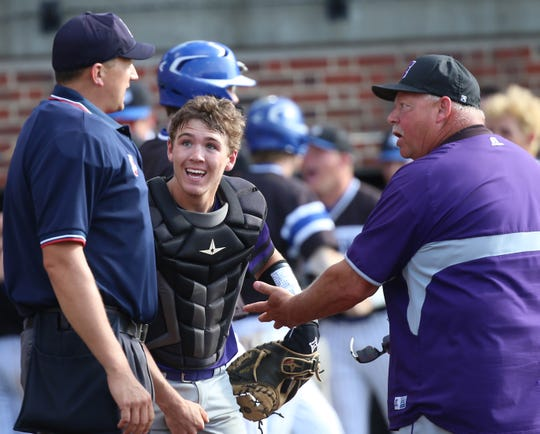 Elder head coach Mark Thompson and catcher Kory Klingenbeck argues the home plate umpire's call  during the Panthers' regional semifinal against Springboro, Thursday, May 30, 2019.