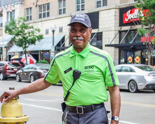 Downtown Ambassadors like Odell Neal (pictured) will now be wearing bright green shirts featuring the 3CDC and DCI logos, rather than the orange and red shirts worn in the past.