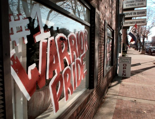 This 1999 file photo shows a window on a business in downtown Lebanon, Ohio, supporting the school district's athletic teams.
