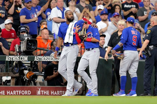 May 29, 2019; Houston, TX, USA; Chicago Cubs center fielder Albert Almora Jr. (5, center) is consoled by right fielder Jason Heyward (22, left) after a fan was hit by a foul ball during the fourth inning against the Houston Astros at Minute Maid Park. Mandatory Credit: Erik Williams-USA TODAY Sports
