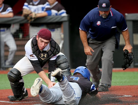 Turpin catcher Nick Kapostasy tries to tag out Springboro runner Adam Berry  during the Spartans' regional final loss on Friday, May 31, 2019.
