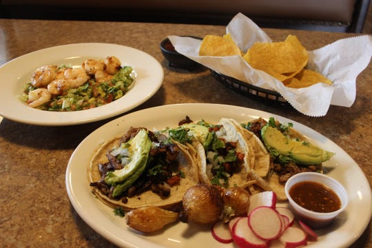 A plate of Tacos Authenticos and a salad featuring grilled shrimp over avocados, called the Ensalada Azteca, are just a few of the menu options at El Rancho Grande in Sango.