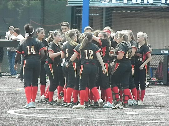 The Mount Olive softball team celebrates its Group IV semifinal win over North Hunterdon on Friday, May 31, 2019 at Ivy Hill Park.