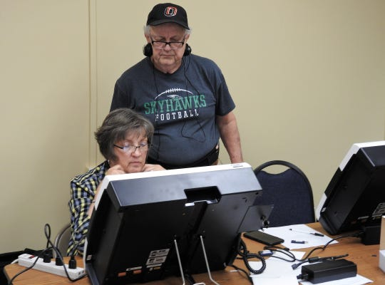 Mike Devereaux of Election Systems and Software oversees Jodi Shrimplin as she tests a new ExpressVote marker machine recently at the Coshocton County Board of Elections. The board got 90 of the machines along with a scanner and tabulator for each precinct and a machine to process paper ballots.