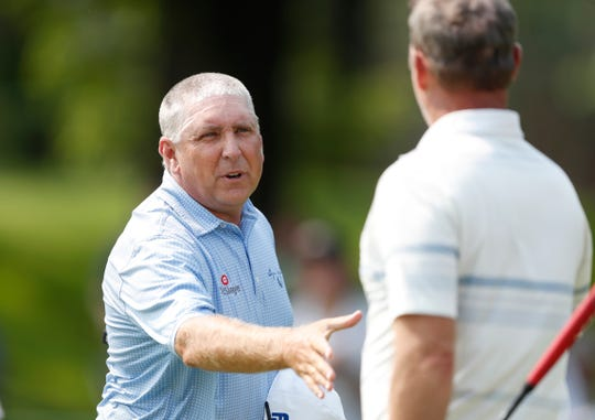 Scott Parel, left, greets Jerry Kelly, right, on the ninth green during the first round of the PGA Tour Champions Principal Charity Classic golf tournament, Friday, May 31, 2019, in Des Moines, Iowa.