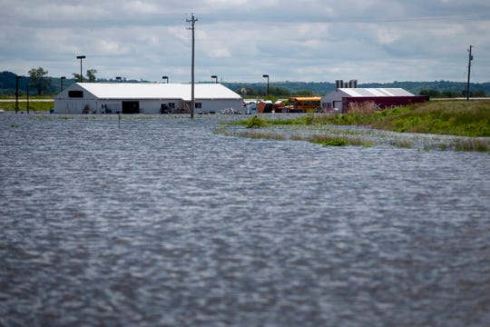 Many homes in Hamburg, Iowa remain unsafe to occupy, with the spring's major flooding posing risks of abrasions, food contaminations and mold exposure.