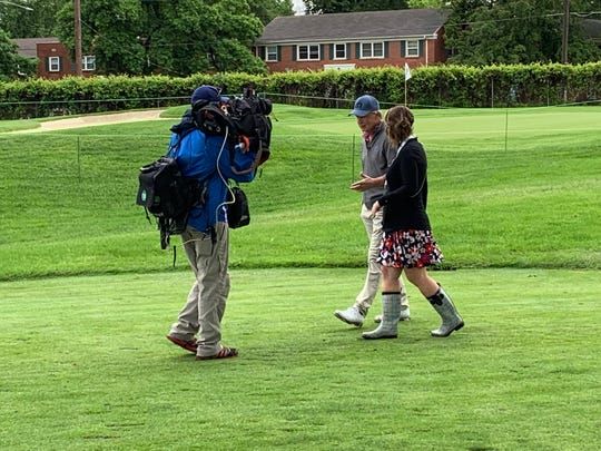 Brandel Chamblee, center was assisting Iowa Live TV host Jackie Schmillen with a live report on Wednesday at the Principal Charity Classic, and he didn't realize he'd hit a tee shot on the par-3 ninth hole to the wrong green at Wakonda Club.