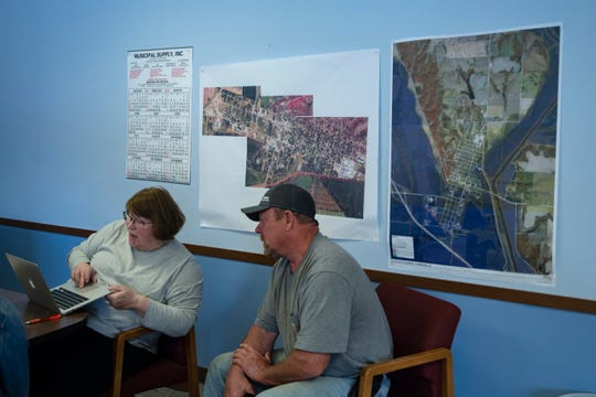 Hamburg mayor Cathy Crain and Hamburg Public Works director Alan Dovel discuss maps of anticipated flood levels on May 29, 2019. Waters were expected to crest to almost 23 feet.