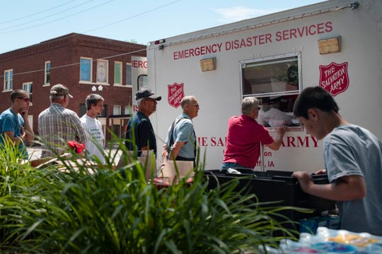 Hamburg residents receive donated meals from a Salvation Army emergency relief truck on May 29, 2019. Following major floods this spring, no operating restaurants remain in Hamburg other than a convenience and drug store, leaving most to travel to Shenandoah, 25 miles northeast, for groceries.