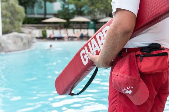 Lifeguard watching a swimming pool