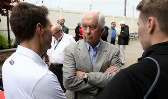 Roger Penske talks with two of his IndyCar drivers (L to R) Will Power and Josef Newgarden on Thursday.