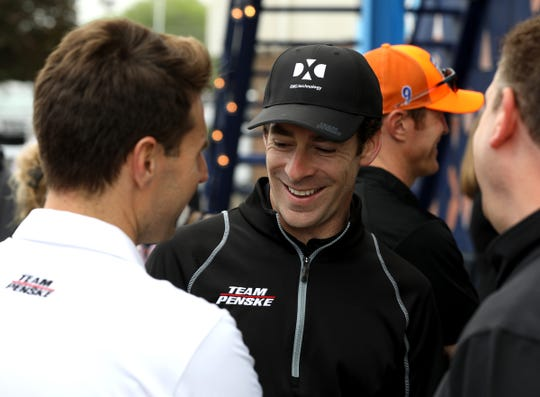 Simon Pagenaud talks with other drivers before the IndyCar media luncheon at The Roostertail in Detroit on Thursday.