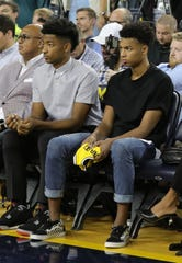 Jace Howard and his brother Jett Howard listen as their dad,  Juwan Howard,  the new Michigan mens basketball coach  takes questions on May 30, 2019 at the Crisler Center in Ann Arbor.