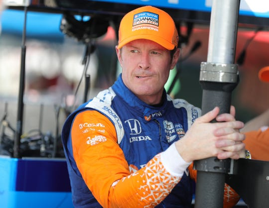 Scott Dixon talks with teammates during practice rounds of the Detroit Grand Prix on Friday.