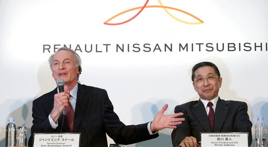 In this March 12, 2019, file photo, Renault Chairman Jean-Dominique Senard, left, speaks as Nissan CEO Hiroto Saikawa listens during a joint press conference at the Nissan headquarters in Yokohama, near Tokyo. Fiat Chrysler's proposal to merge with Renault was presented to Nissan on Wednesday, May 29, adding another big question to the list of uncertainties facing the Japanese automaker.
