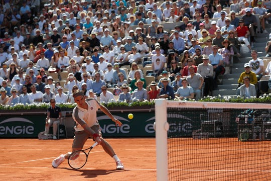 Roger Federer plays a shot against Casper Ruud during their third round match of the French Open in Paris on Friday.