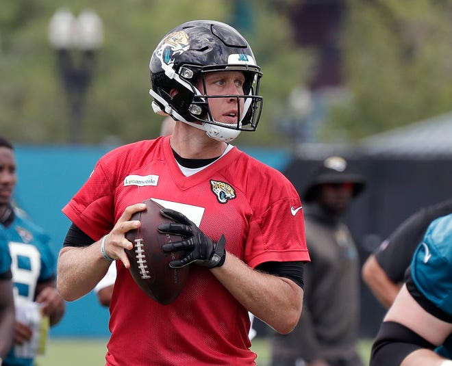 Jacksonville Jaguars quarterback Nick Foles looks for a receiver during a practice Friday.
