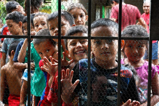 Migrant children line up for a meal at the door of the Jesus del Buen Pastor del Pobre y el Migrante shelter, in Tapachula, Chiapas state, Mexico, Thursday, May 30, 2019.