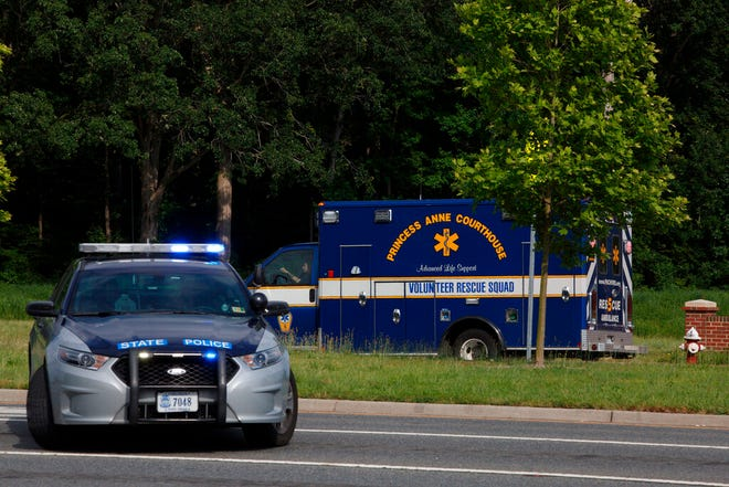 An ambulance turns on Nimmo Parkway following a shooting at the Virginia Beach Municipal Center on Friday, May 31, 2019, in Virginia Beach, Va. At least one shooter wounded multiple people at a municipal center in Virginia Beach on Friday, according to police, who said a suspect has been taken into custody.