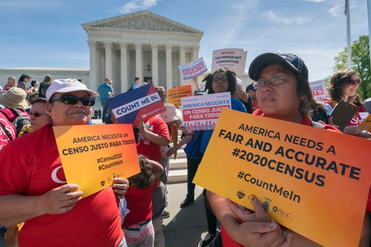 Immigration activists rally outside the Supreme Court as the justices hear arguments over the Trump administration's plan to ask about citizenship on the 2020 census, in Washington. A new court filing  by lawyers opposing adding the citizenship questionalleges a longtime Republican redistricting expert played a key role in making the change.