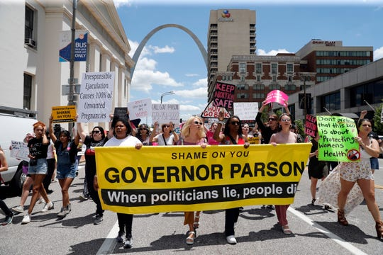 Abortion-rights supporters march Thursday, May 30, 2019, in St. Louis.