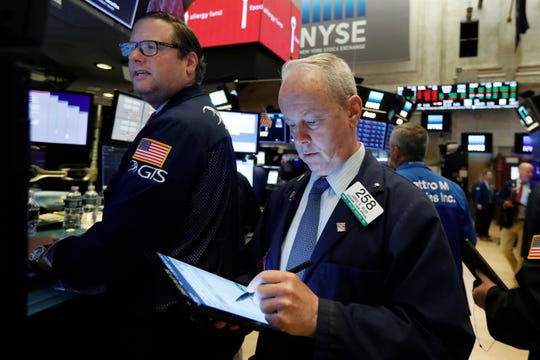 Specialist Gregg Maloney, left, and trader James Riley works on the floor of the New York Stock Exchange, Thursday, May 30, 2019. U.S. stocks tumbled Friday after the U.S. announced plans to expand its trade war to Mexico.  The slump all but guarantees that May will be the first monthly loss for the market in 2019.