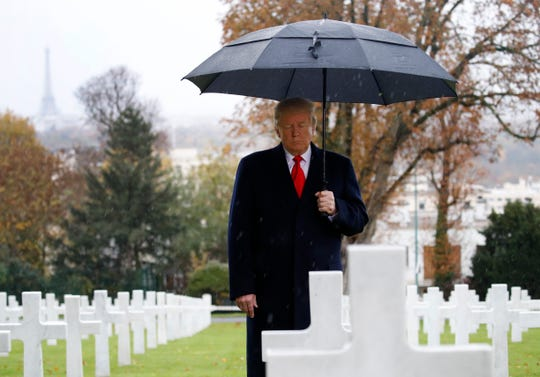 U.S. President Donald Trump stands among the headstones during an American Commemoration Ceremony at Suresnes American Cemetery near Paris in November 2018. President Trump and his French counterpart Emmanuel Macron will next week honor the dwindling number of veterans who survive from that invasion.