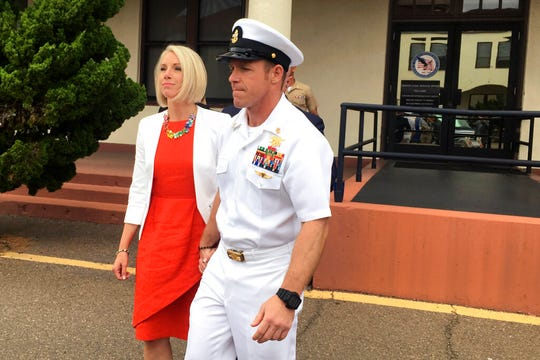 Navy Special Operations Chief Edward Gallagher leaves a military courtroom on Naval Base San Diego with his wife, Andrea Gallagher, Thursday, May 30, 2019, in San Diego. The decorated Navy SEAL facing a murder trial in the death of an Islamic State prisoner was freed Thursday from custody after a military judge cited interference by prosecutors.