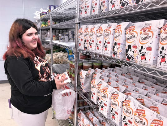 Greater Southern Tier BOCES student Hermione Buckley, of Elmira Heights, looks over the selection of items in the new food pantry on the BOCES campus in Horseheads.