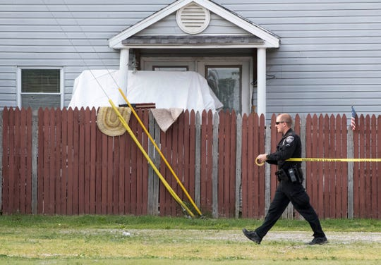 An EPD officer tapes off the block of 900 Park Street and 1600 W Maryland Street after one person was taken to hospital after a shooting Friday, May 31, 2019.