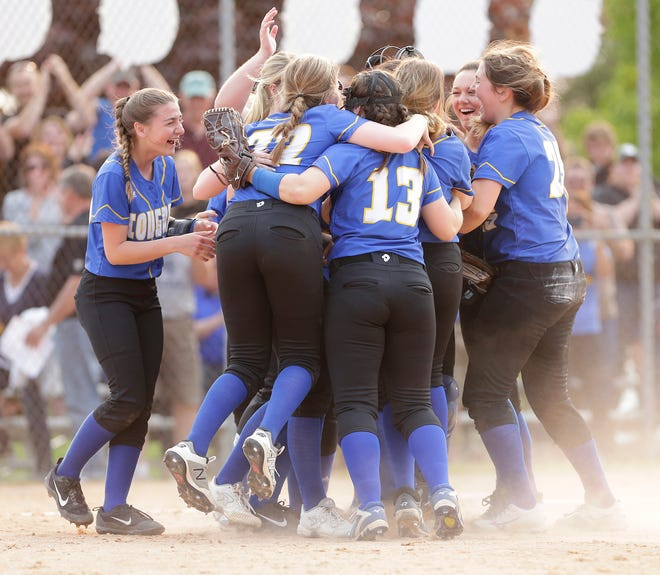 Campbellsport softball players celebrate their win over Random Lake in May 2019 in a WIAA Division 3 sectional final softball game in Mayville.