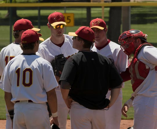 Fort Collins Foxes infielders huddle on the mound during a 2017 game. The Foxes, a summer collegiate baseball team, will play a road game at 4:30 p.m. Monday against the Denver Cougars at Mountain Vista High School in Highlands Ranch.