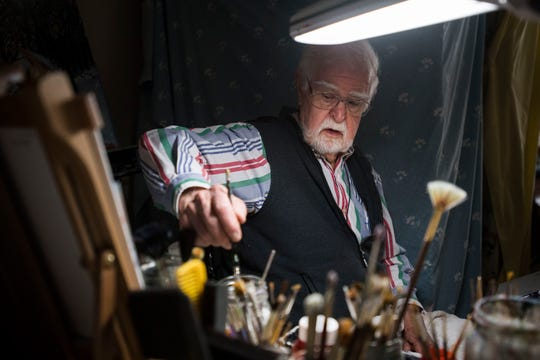Painter Norm Oliphant, 94, works in his basement studio on Friday, May 31, 2019, at his home in Windsor, Colo.