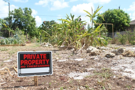 """A """"No Trespassing"""" sign posted in front of the community garden in Naples Park."""