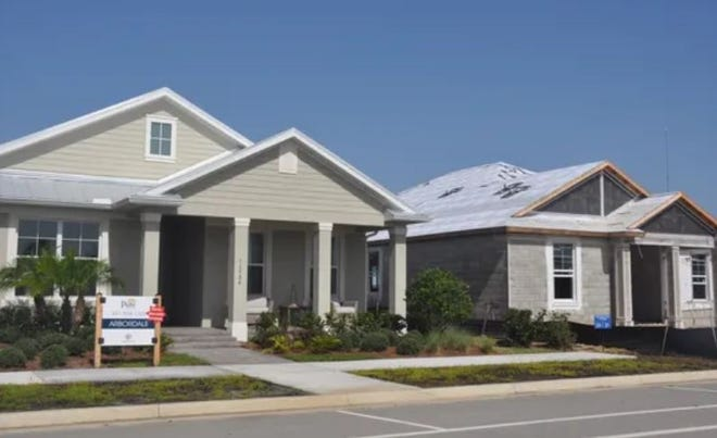 A model home and one for sale at Babcock Ranch on the North Fort Myers/Charlotte County line. The engineering firm on the project went seven years without filing required lobbyist registration forms