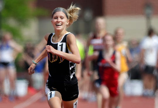 Denmark's Leah Kralovetz takes first place in the Division 2 1,600-meter run during the WIAA state track and field meet Friday, May 31, 2019, at Veterans Memorial Field Sports Complex in La Crosse, Wis.