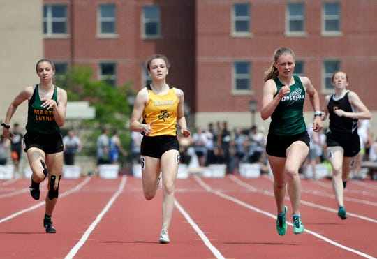 Freedom's Grace Hambel runs in the division 2 400 meter dash during the WIAA state track and field meet Friday, May 31, 2019 at Veterans Memorial Field Sports Complex in La Crosse, Wis.