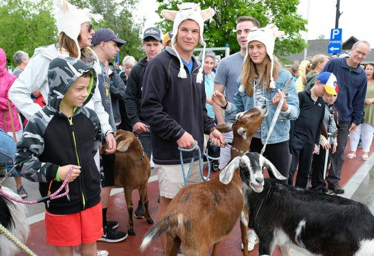 Two- and four-legged marchers get ready for last year's Roofing of the Goats Parade in Sister Bay. This year's parade and Goat Fest take place Saturday, June 8.