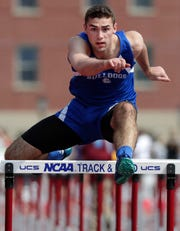 Peshtigo's Mitchell VanVooren competes in the Division 2 110-meter high hurdles during the WIAA state track and field meet Friday.