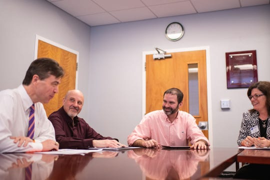 From left, Timothy Fulford of Trident Technical College, Joe Santaniello of Spartanburg Community College, Christopher Kitchens of Clemson University and Shawn Masto of Spartanburg Community College meet in Clemson University's Earle Hall to plan for the SPECTRA transfer student program.