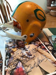 A Packers youth football helmet and autographed photo from Bart Starr are among the memorabilia cherished by Andy Cone.