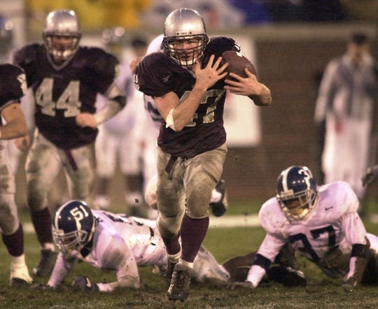 Montana strong safety Vince Huntsberger runs 65 yards for a touchdown on a fake punt play against Georgia Southern in the fourth quarter during the NCAA I-AA national championship game on Dec. 16, 2000, in Chattanooga, Tenn.