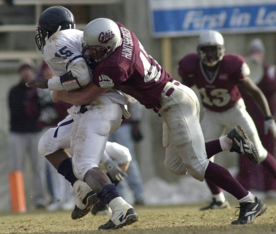 Montana's Vince Huntsberger tackles a Richmond running back during playoff action in 2000. Tribune file photo