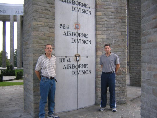 Greg, left, and Scott Stephens pose near a monument in Bastogne, Belgium. William H. Stephens, father of the men, grew up in Sand Coulee and served with the 502nd PIR in the 101st Airborne Division, which fought on D-Day in France, in Holland during Operation Market Garden and in Bastogne during the Battle of the Bulge.