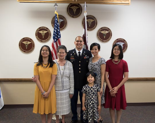 David Ouano was promoted to Lieutenant Colonel on May 23 at General Leonard Wood Army Community Hospital. Quano is currently stationed at Fort Leonard Wood, Missouri. Pictured from left: Katherine (daughter), Marie Quintanilla (mother), David Ouano, Stephanie (wife), Kamille (daughter), Olivia (daughter).