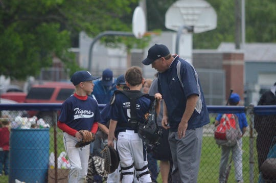 A meeting at the mound during this Franklin Township Little League game from 2017.