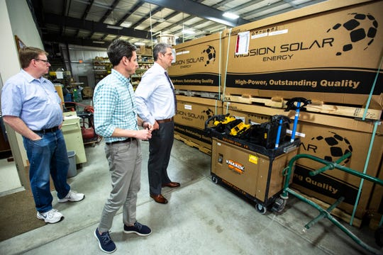 U.S. Rep. Tim Ryan, D-Ohio, takes a tour with Tyler Olson, CEO of Paulson Electric Company, of the SiteGen Solar business with Iowa Sen. Rob Hogg, D-Cedar Rapids, Friday, May 31, 2019, at Paulson Electric Company in Cedar Rapids, Iowa.
