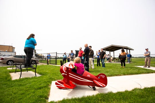 Asher Ackermann, 9, (in plane) listens Michael Tharp speak during a ribbon cutting event for a new viewing area, Friday, May 31, 2019, at the Municipal Airport in Iowa City, Iowa.